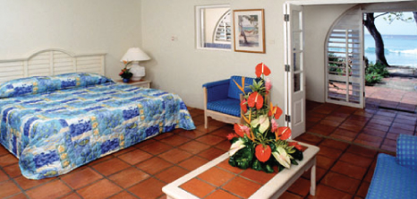 Beautiful Bouquet of Flowers Sits on a Table in a Room at Divi Heritage, Sunset Crest, St. James, Barbados Pocket Guide