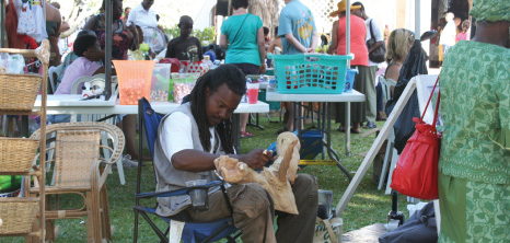 Sculptor at Work at Holetown Festival, St. James, Barbados Pocket Guide