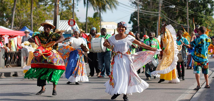 Dancers in the Streets at Holetown Festival, St. James, Barbados Pocket Guide