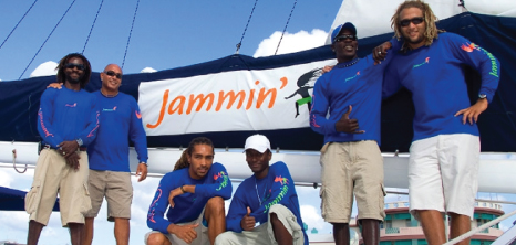 Crew Members Get Together for a Photo on Board Jammin' Catamaran Cruises, Barbados Pocket Guide