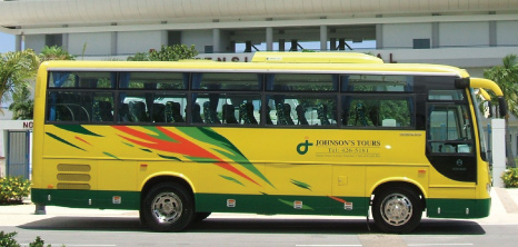 A Johnson's Tours Bus Waiting on Passengers Outside Kensington Oval, Bridgetown, Barbados Pocket Guide
