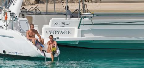 Couple Getting Ready to Swim with the Turtles, Silver Moon Luxury Catamarans, Barbados Pocket Guide