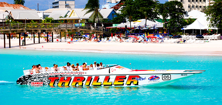 Excited Visitors on Board Thriller's Specially Designed 55' Off-Shore Power Boat, Wave Their Hands in Excitement as They Head Out to a Sea Turtle & Shipwreck Snorkel, Barbados Pocket Guide