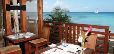 Dinner Tables Overlooking the Sea, Daphnes Restaurant, Paynes Bay, St. James, Barbados Pocket Guide