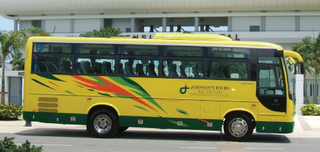 Johnson's Tours Bus Awaiting Passengers Outside Kensington Oval, Barbados Pocket Guide