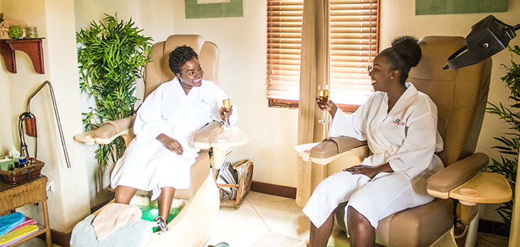 Masseuses at Sugar Cane Club Hotel & Spa Massaging a Couple, Barbados Pocket Guide