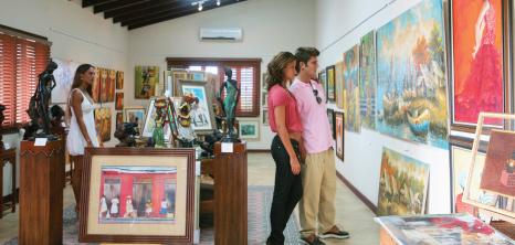 Art Enthusiasts Viewing Paintings at Frangipani Art Gallery, Sugar Cane Club Hotel and Spa, St. Peter, Barbados Pocket Guide