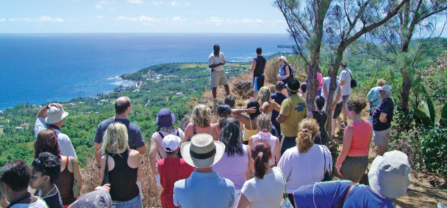 An Island Safari Tour Guide Educating Guests about Barbados