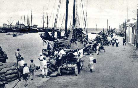 Goods Being Offloaded at the Careenage in Years Gone By, Barbados Pocket Guide