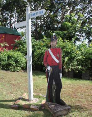 Cardboard Cut Out of a Soldier on the Lawns of Gun Hill Signal Station, St. George, Barbados Pocket Guide