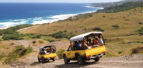 Adventureland 4X4 Jeeps on Tour Going Down a Steep Hill at East Coast, Barbados Pocket Guide