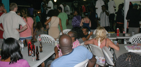 Locals & Visitors Liming at Oistins, Christ Church, Barbados Pocket Guide