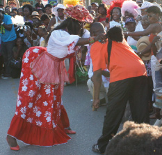 Mother Sally Dancing in the Streets at Holetown Festival with an Onlooker, Barbados Pocket Guide