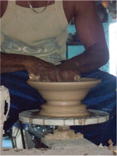 Potter at Work with Clay on a Potters Wheel, Chalky Mount Potteries, Chalky Mount, St. Andrew, Barbados Pocket Guide