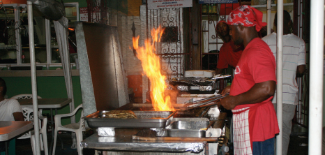 Chef Frying Fish Outdoors at Oistins Fish Fry, Oistins, Christ Church, Barbados Pocket Guide