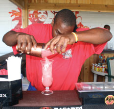 A Barman Mixing a Fruit Punch at Copacabana Beach Bar & Grill, Barbados Pocket Guide