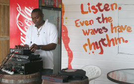 A DJ Plays Music at Copacabana Beach Bar & Grill, Bay Strret, St. Michael, Barbados Pocket Guide