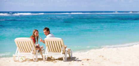 Visitors Relaxing on the Beach, Barbados Pocket Guide