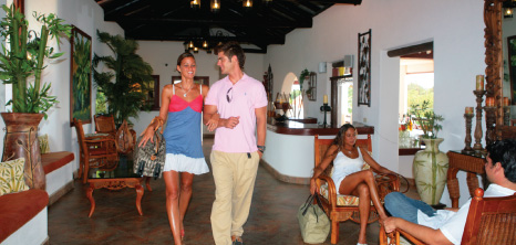 Couple Walking Through the Lobby at Sugarcane Club Hotel & Spa, St. Peter, Barbados Pocket Guide